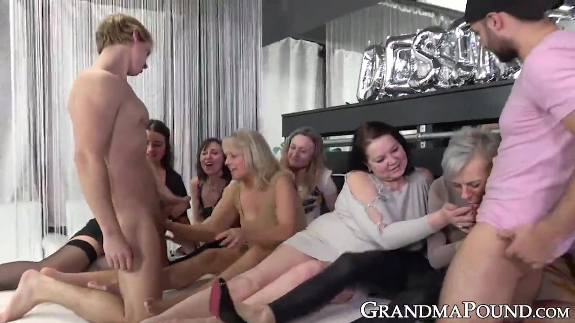 Gang of grandmas absorbs a couple of giant young rock hard jocks Orgy movie scene with tons of grandmothers engulfing on youthful knobs and they love the feeling of it all too