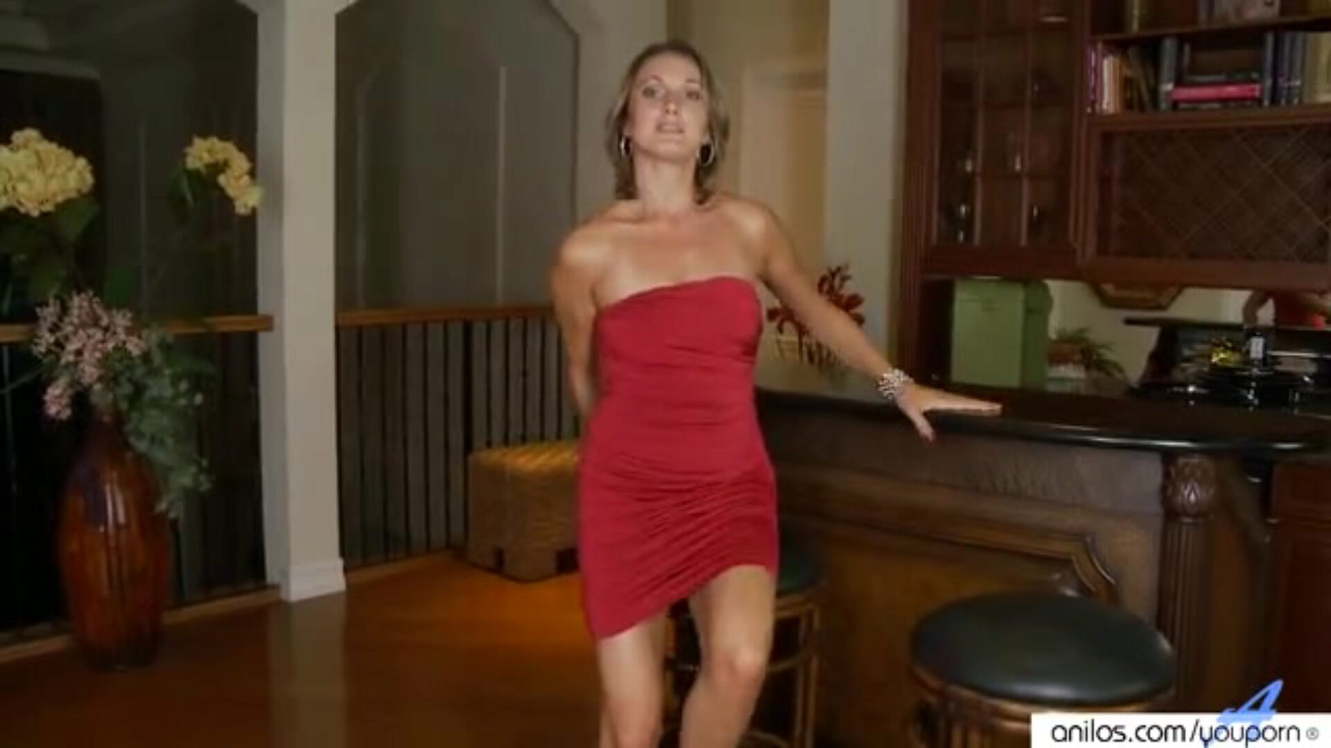 High heeled milf toys herself Milf in a hot red dress and belt strips her lean bod undressed and fucktoys her love tunnel dressed in no thing but glossy silver heels